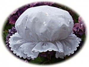 Baby's broderie anglaise mob cap